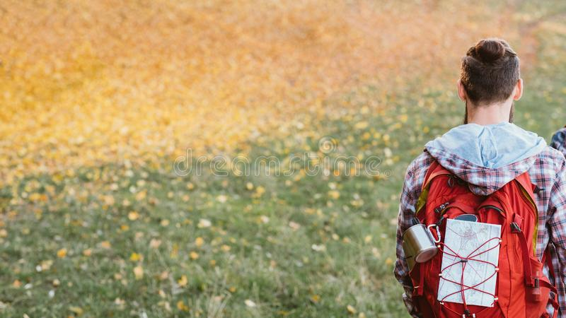 Traveler lifestyle man backpack fall meadow nature royalty free stock images