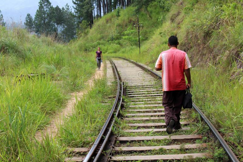 A traveler and a local meeting on the rail going to or from Ella stock images