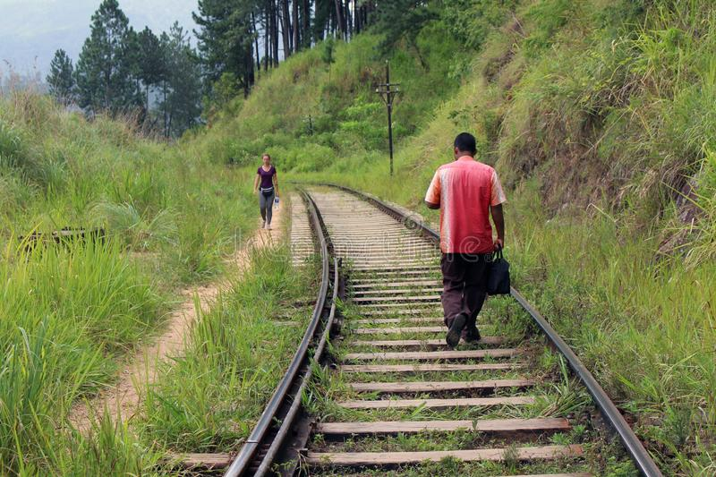 A traveler and a local meeting on the rail going to or from Ella stock photography