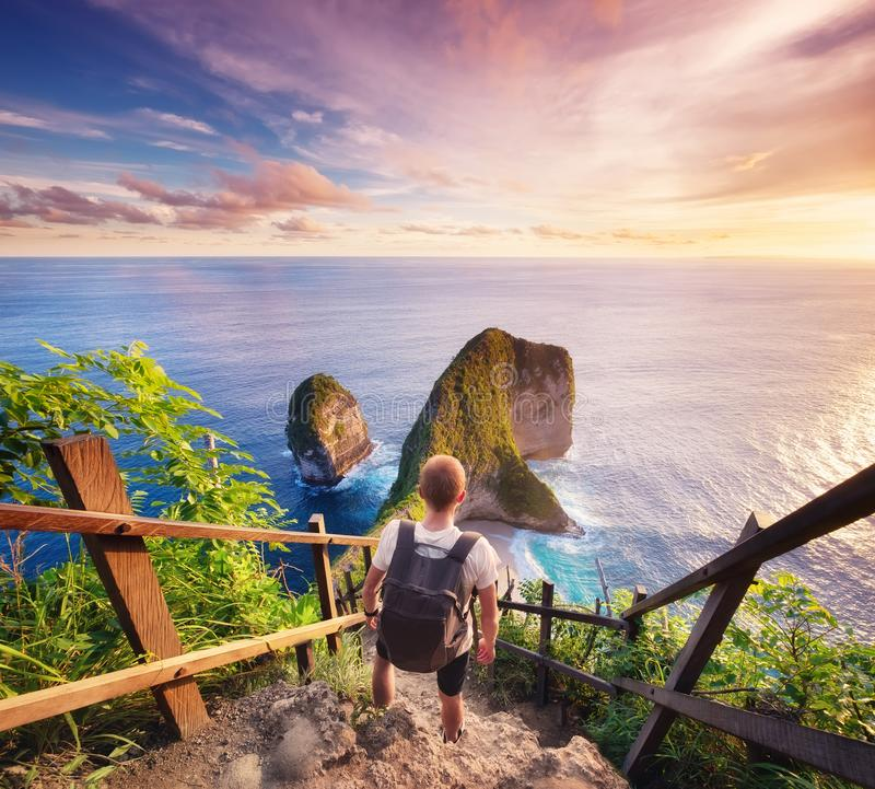 Traveler look at the ocean and rocks. Travel and active life concept. Adventure and travel on Bali, Indonesia. Travel - image stock images