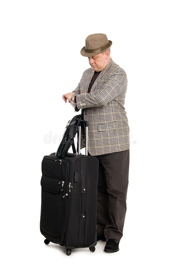 Traveler With Luggage Looks At His Watch Stock Photography