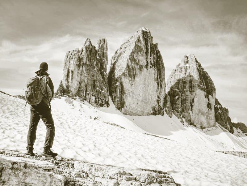 Traveler Man enjoying serene view Tre Cime mountains stock photos