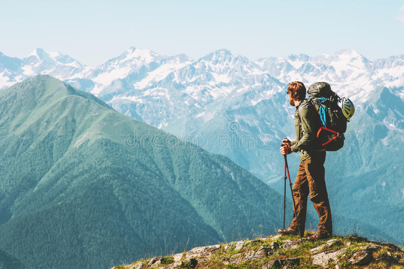 Traveler Man hiking with backpack Travel Lifestyle stock photo