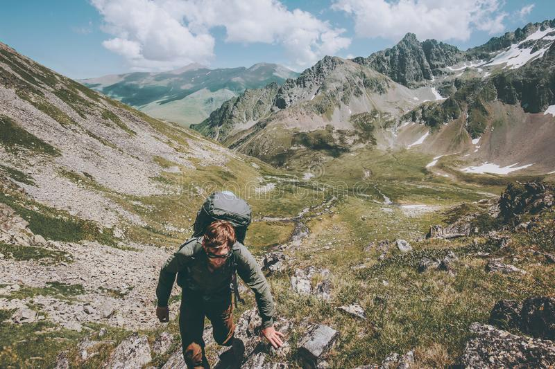 Traveler Man hiking expedition with backpack Travel Lifestyle concept adventure summer vacations outdoor. Mountains landscape on background royalty free stock images