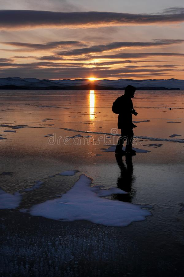 Traveler man and photographer walking across ice field of frozen royalty free stock images