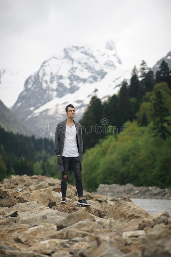 Traveler Man relaxing meditation with serene view mountains and lake landscape Travel Lifestyle hiking concept summer stock image