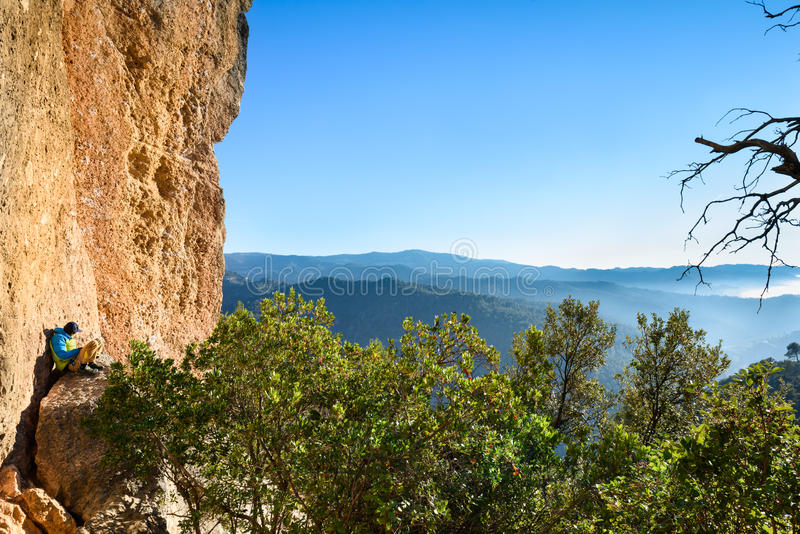 Traveler Man relaxing meditation with serene view of mountains. Travel Lifestyle hiking concept summer vacations outdoor. Spain stock photos
