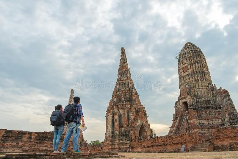 Traveler man and women with backpack walking in asia temple Ayuttaya, royalty free stock photos