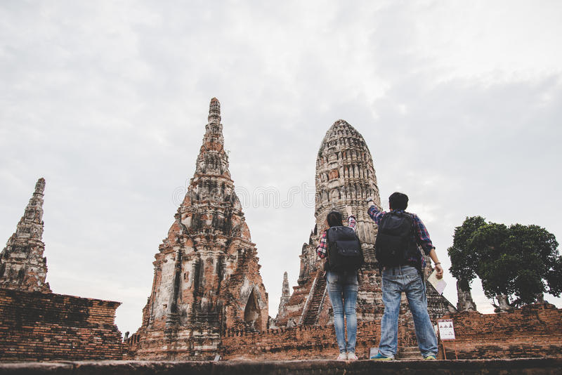 Traveler man and women with backpack walking in temple Ayuttaya royalty free stock photo