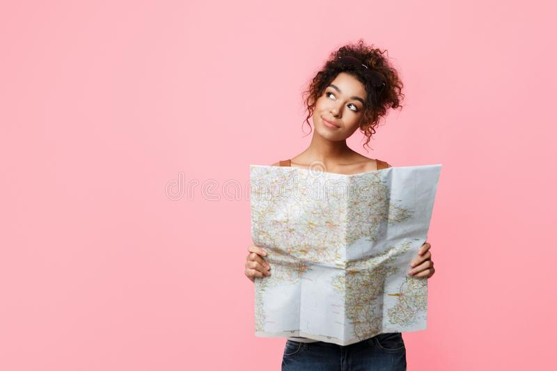 Traveler with map dreaming about trip, copy space royalty free stock photos