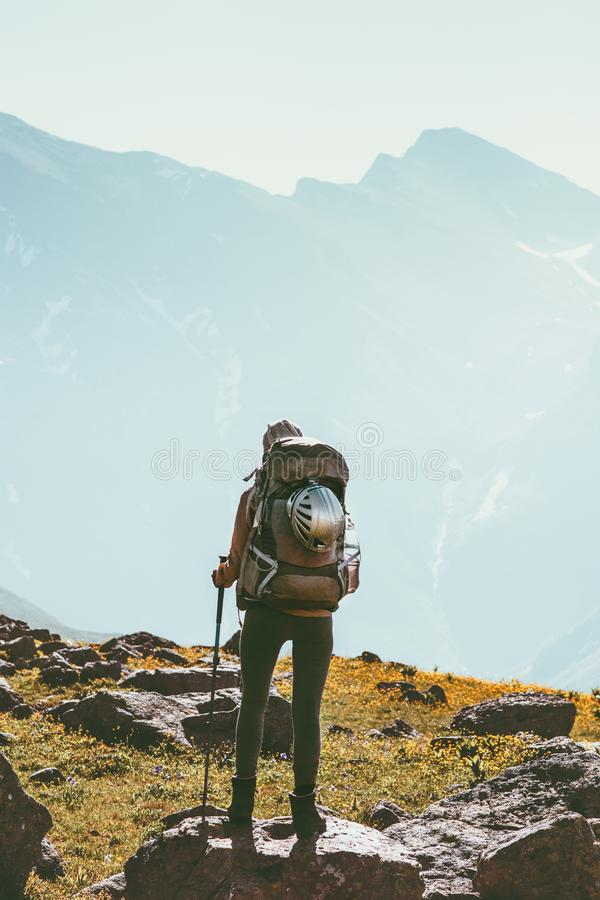 Traveler in mountains hiking with big backpack gear royalty free stock image