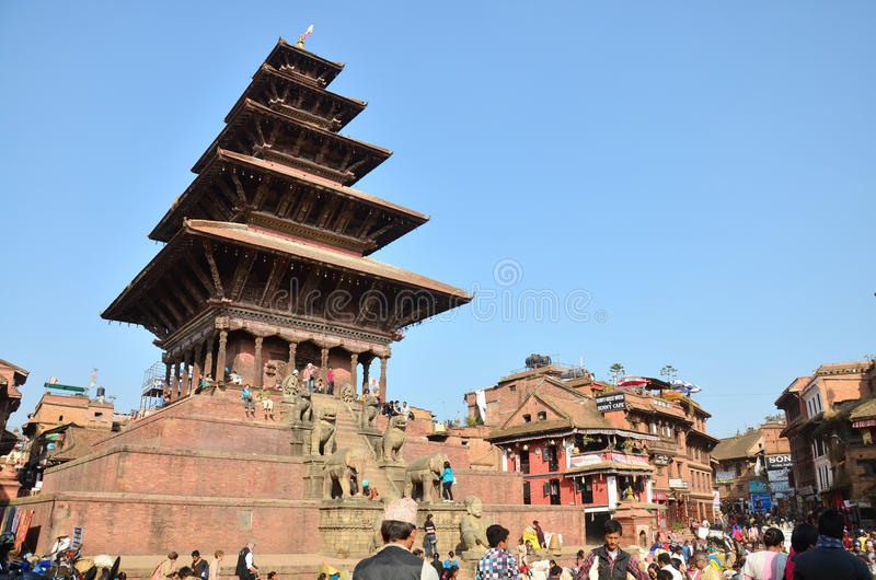 Traveler and Nepalese people come to Bhaktapur Durbar Square. For tour and leisure in Bhaktapur Nepal. Bhaktapur literally translates to Place of devotees. It stock photo