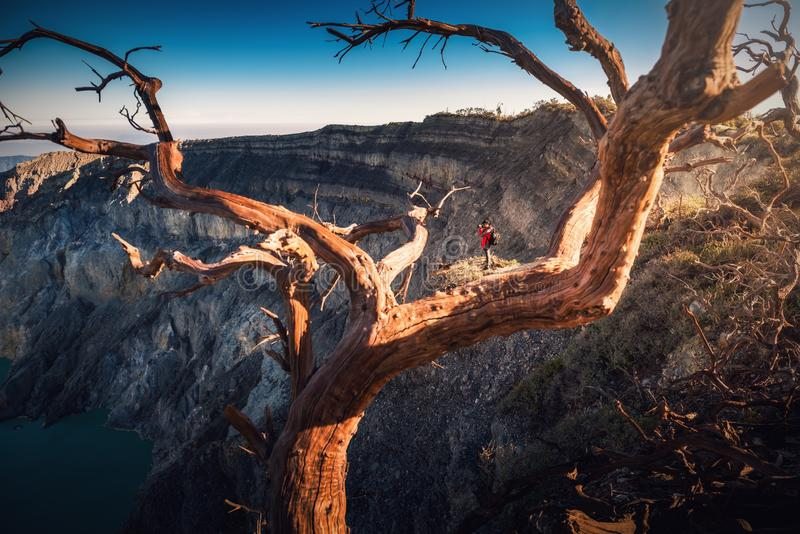 Traveler photographer is shooting landscape picture at Kawah Ijen volcano, National Park of Indonesia.,Outdoor adventure traveling royalty free stock photography