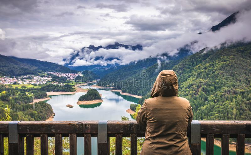 Traveler relaxing meditation with serene view mountains and lake royalty free stock photos
