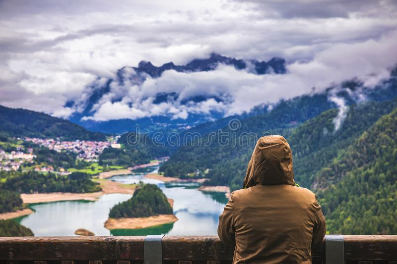 Traveler relaxing meditation with serene view mountains and lake stock photos