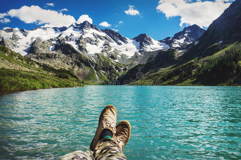 Traveler resting on a mountain plateau royalty free stock photo