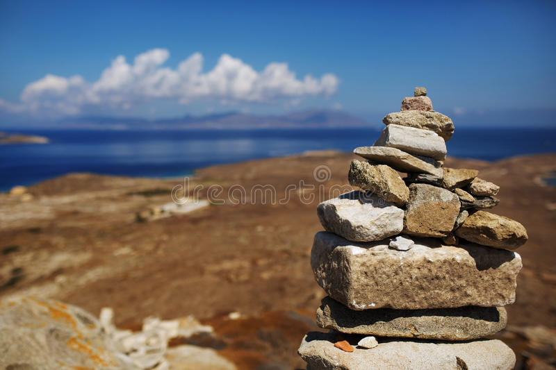 Traveler's Rock Pile. At the highest point on Delos island. Photo has a shallow depth of field with focus on the largest rocks in the stack. Out of focus view royalty free stock images