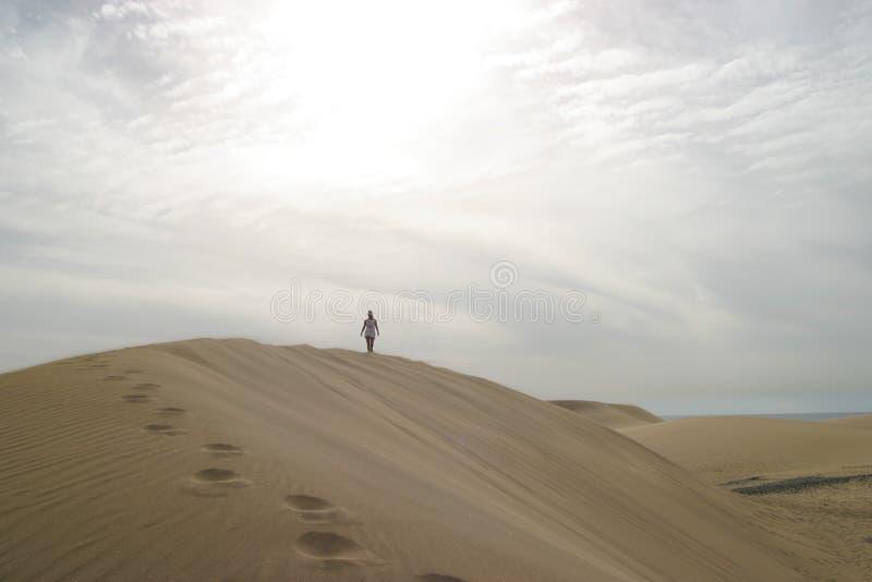 Traveler on sand dune royalty free stock photo