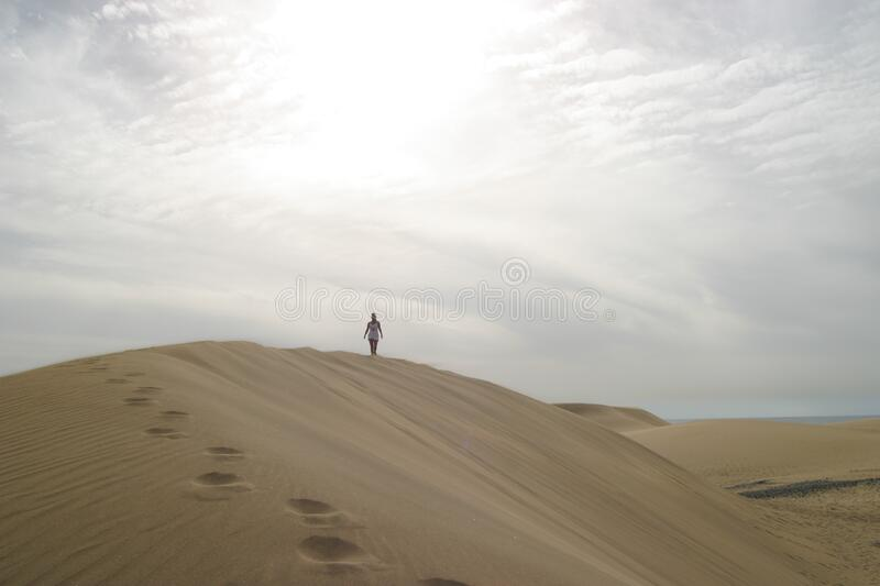 Traveler on sand dune royalty free stock photo