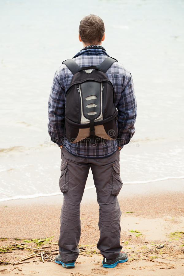 Traveler on Sea coast. Young adult man stock images