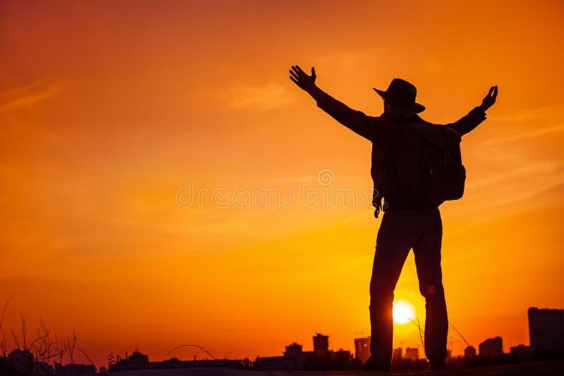 Traveler silhouette enjoying freedom, victory, success. royalty free stock image