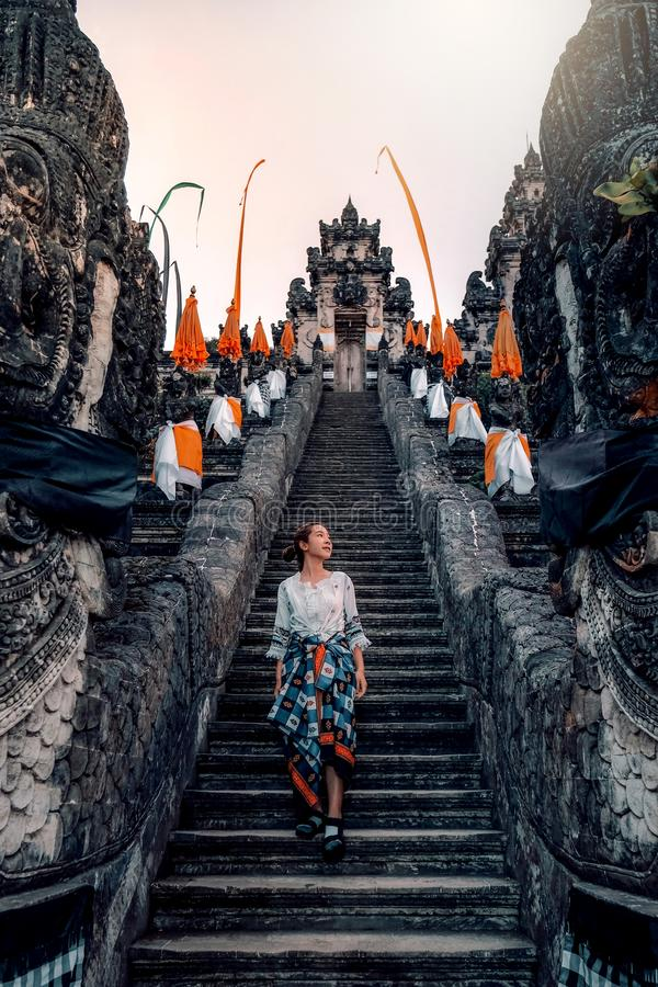 Traveler Standing at the Gates of Pura Lempuyang Temple aka Gates of Heaven Bali, Indonesia royalty free stock photo