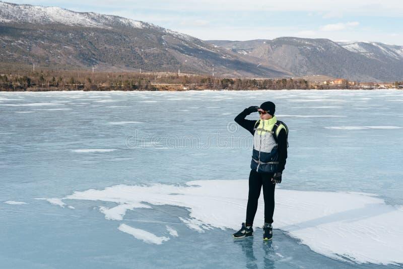 Traveler standing on ice. stock image