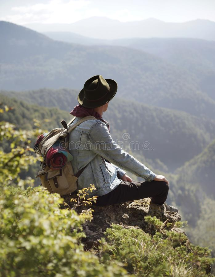 Traveler staring at the mountains. royalty free stock photography