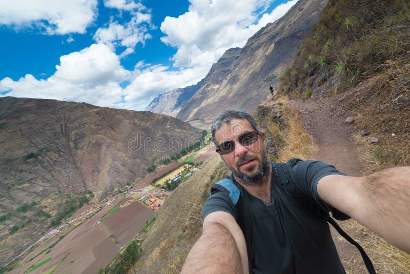 Traveler taking selfie in the Inca's Sacred Valley, Peru. Fellow traveler taking selfie while visiting Inca site of Pisac, Sacred Valley, major travel royalty free stock image