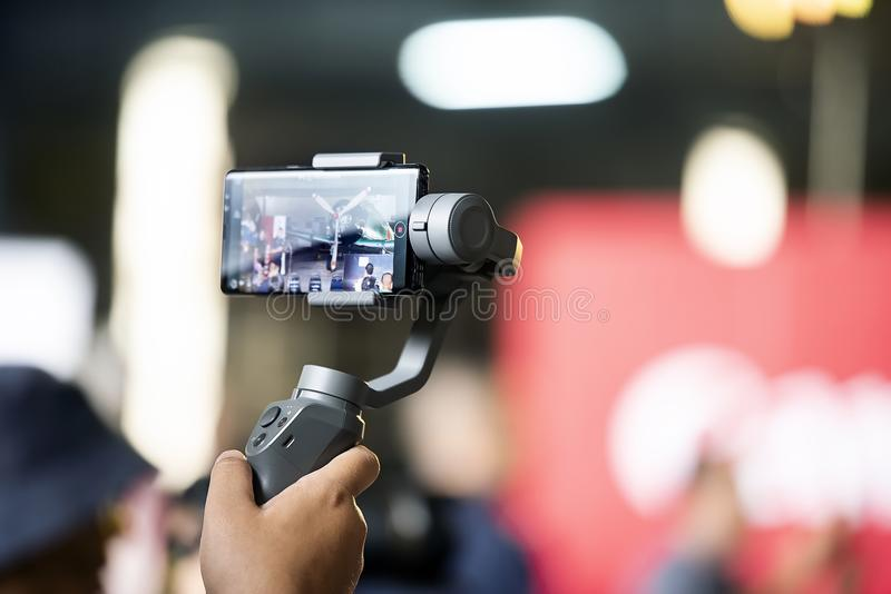 Traveler taking video with smartphone stock photo