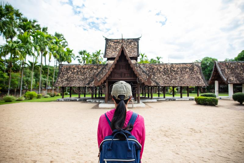Traveler at temple in Chiangmai, Thailand. Back view of traveler wowan standing at Wat Ton Kwen Wat Inthrawat, ancient temple in Chiang Mai, Thailand royalty free stock photography