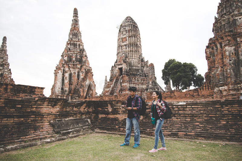 Traveler and tourist asian man and women with backpack walking in temple Ayuttaya ,Thailand. royalty free stock photos