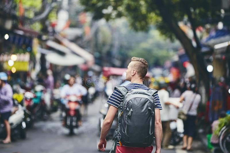 Traveler walking on busy street stock photography