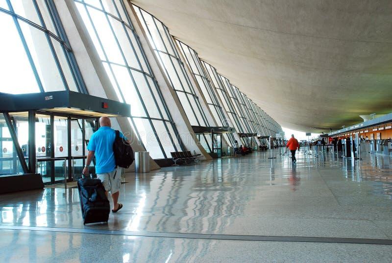 Main Terminal at Dulles International Airport. A traveler walks into the Main Terminal at Dulles International Airport stock photo