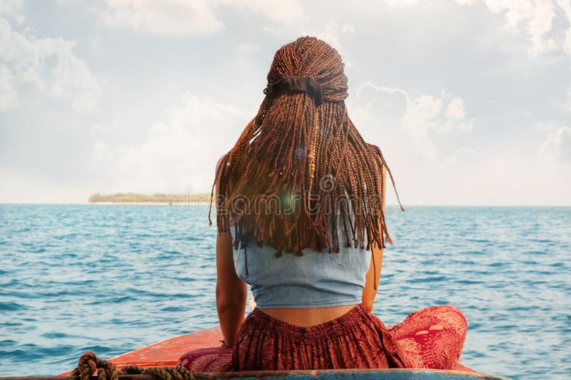 Traveler woman on boat backview royalty free stock image