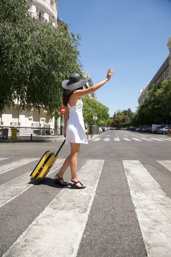 Download Traveler Woman Calling A Taxi Stock Photo - Image: 20854122