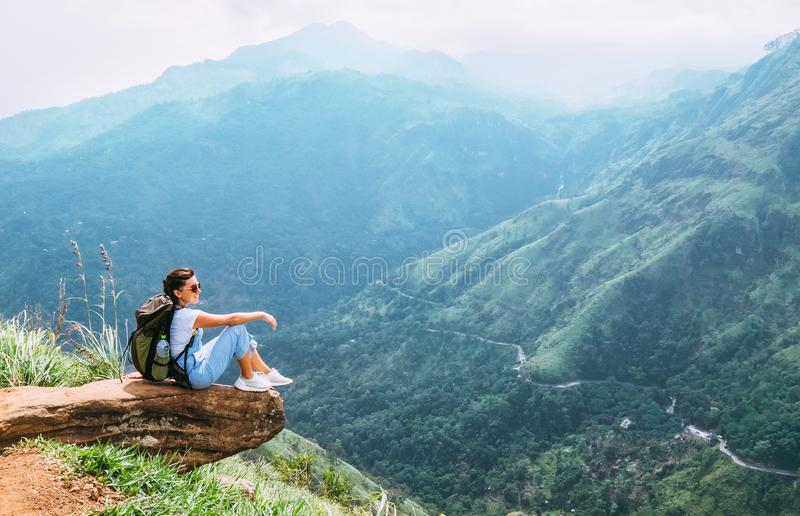 Traveler woman enjoy with mountains landscape. Travel concept va. Cations hiking with backpack in mountains stock photos
