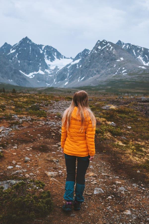 Traveler woman enjoying mountains view outdoor royalty free stock image