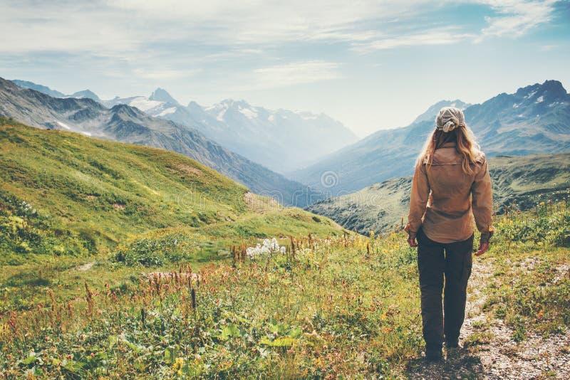 Traveler Woman hiking in mountains stock photo