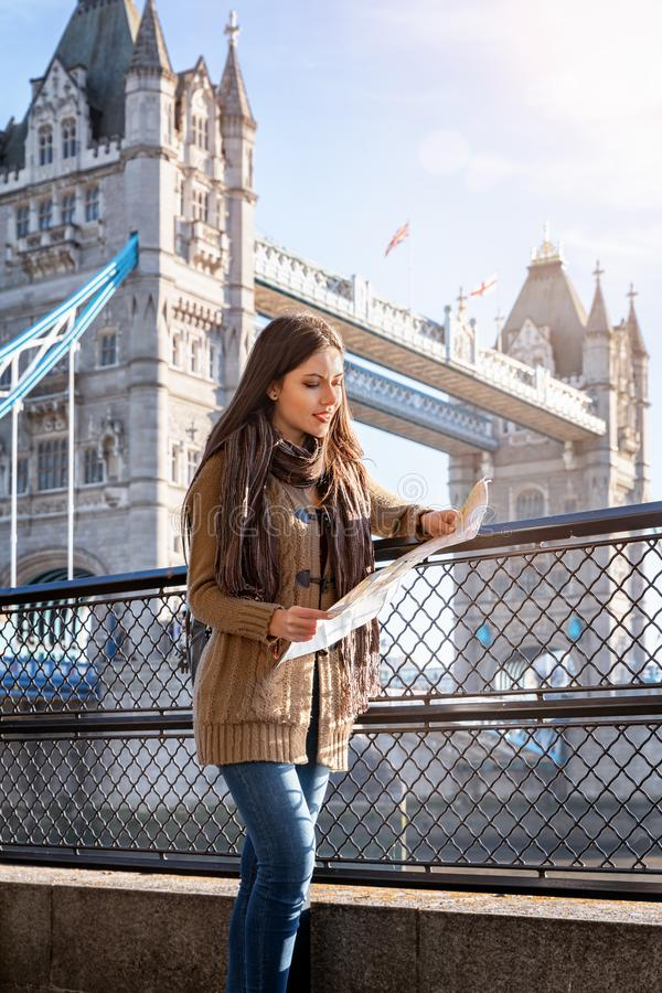 Traveler woman looks at the map in London,UK royalty free stock photos