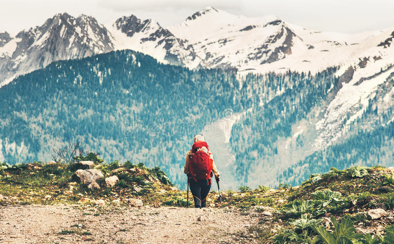 Traveler woman with red backpack mountaineering stock images