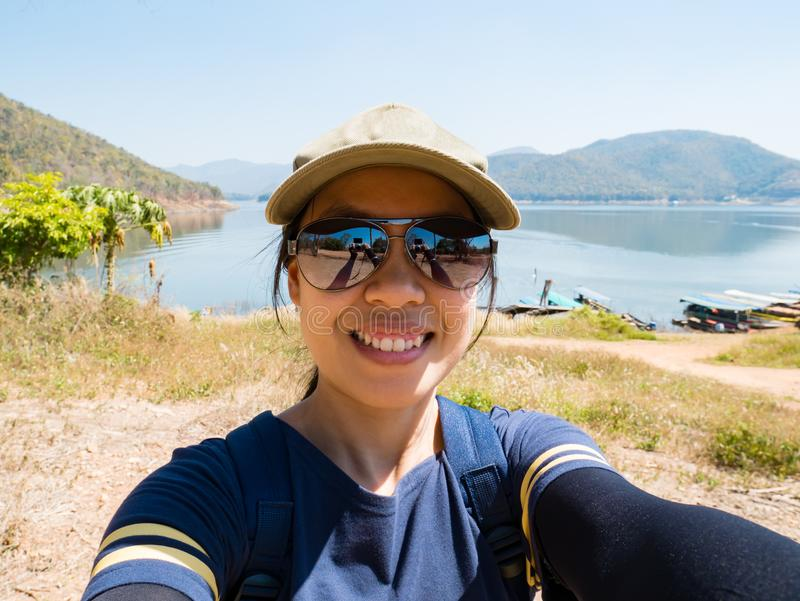 Traveler woman take picture by herself stock photography