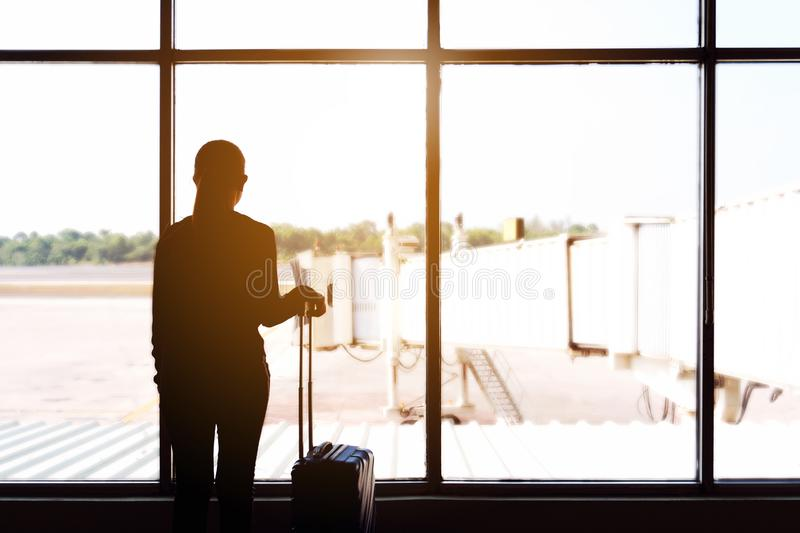 Traveler women and luggage at airport terminal Travel concept royalty free stock photos