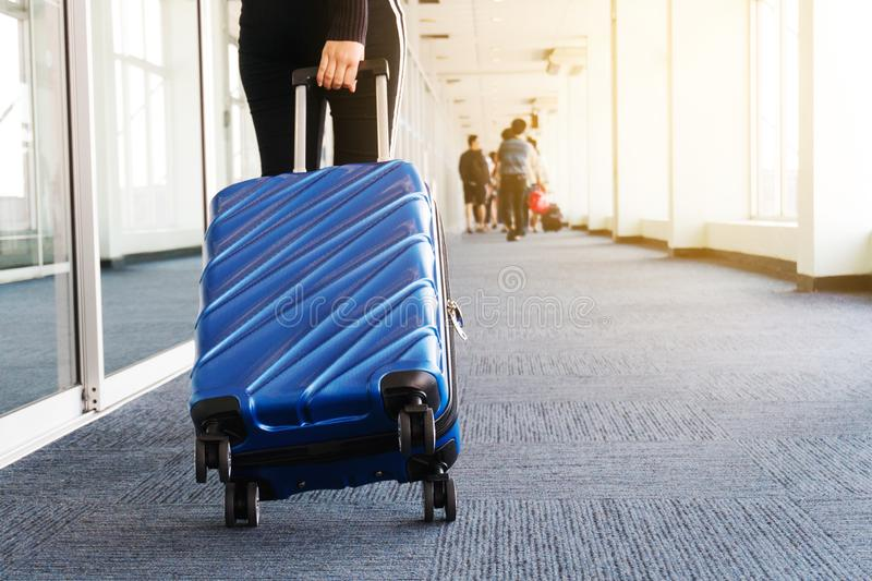 Traveler women and luggage at airport terminal Travel concept stock photo