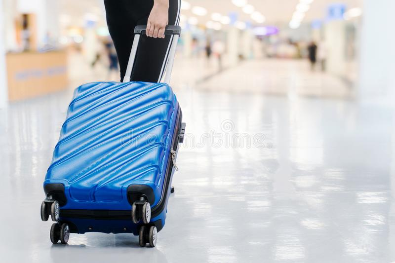 Traveler women and luggage at airport terminal Travel concept royalty free stock image