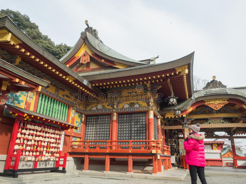 Travelers appreciate the beauty of the shrine YÅ«toku Inari that are quiet in the morning before a full crowd with a tour group. royalty free stock photo