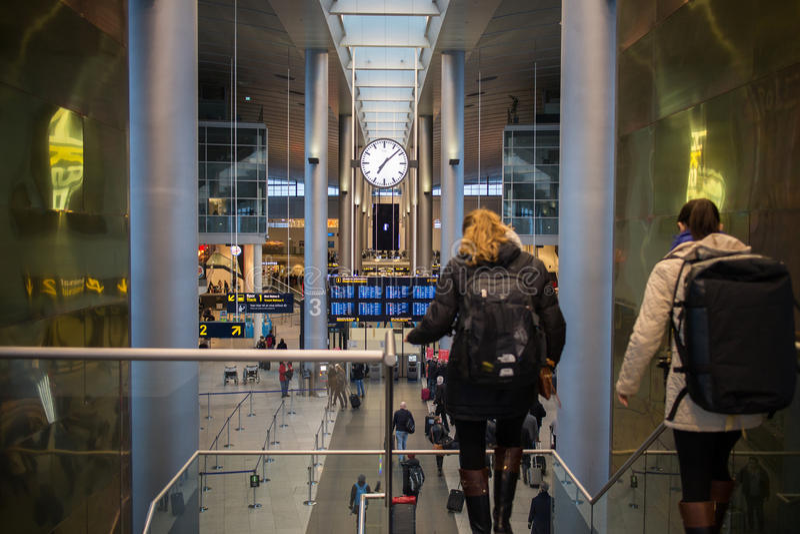 Travelers in Copenhagen Airport stock images