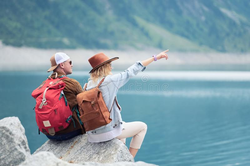 Travelers couple look at the mountain lake. Travel and active life concept with team. Adventure and travel in the mountains region stock photos