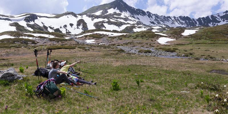 Travelers in the mountains resting on the camping. stock photos