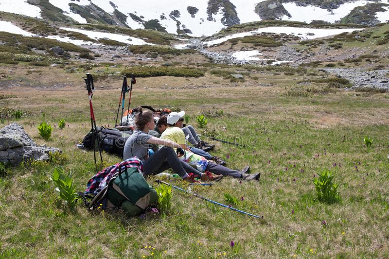 Travelers in the mountains resting on the camping. royalty free stock photos